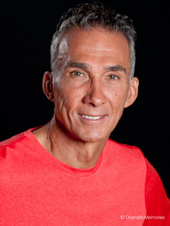 smiling middle aged man in a red t-shirt