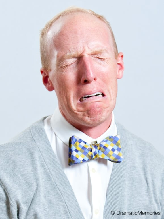 crying actor in white shirt and bow tie
