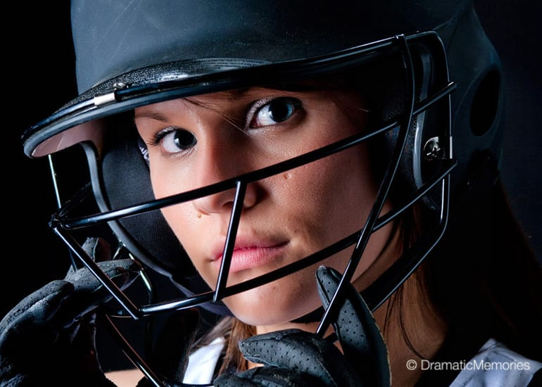 close-up of girl softball player wearing a batting helmet