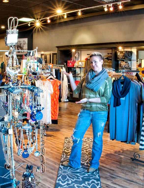 business owner standing in her women's clothing shop