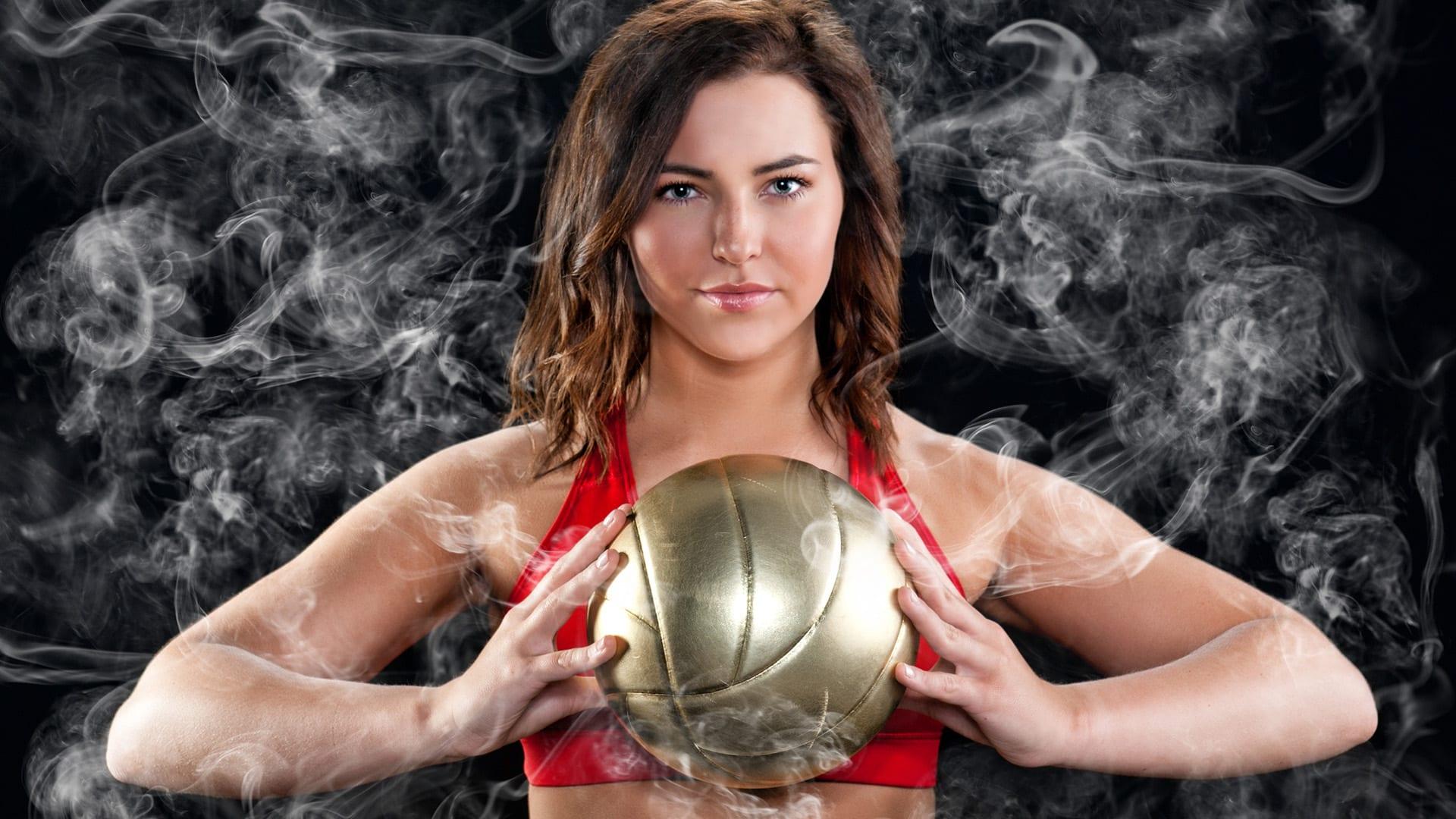 senior girl volleyball player holding volleyball